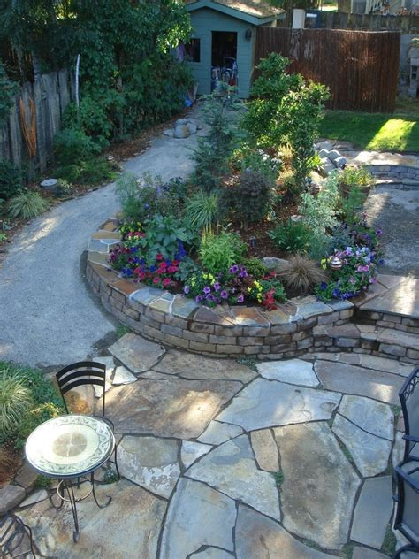The New Multi Tiered Backyard With Flagstone Patio Tiered Backyard Landscaping Ideas