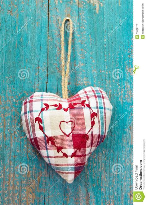rustic heart  turquoise wooden surface  wedding