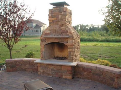 outdoor stone fireplace outdoor fireplace with custom brick design elements in new