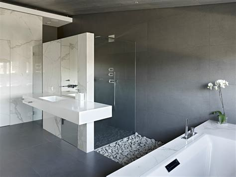 sleek bathroom design invisible doors turn a home into an artistic feat of design