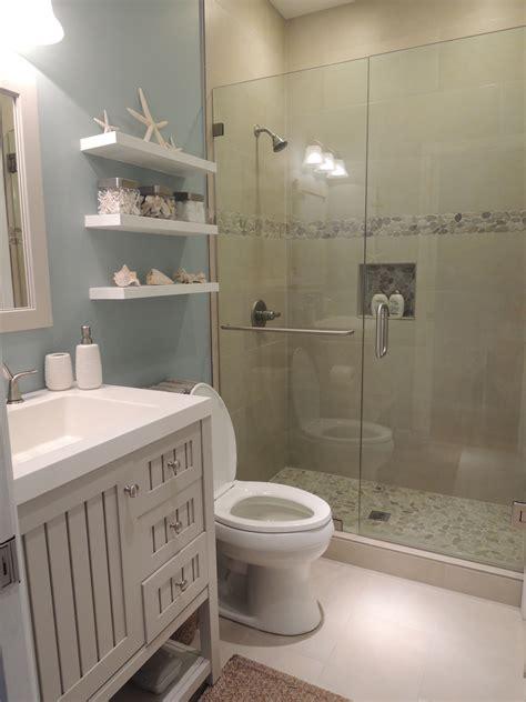 Beach theme bathroom stone shower floating shelves shell decor our hawaiian home
