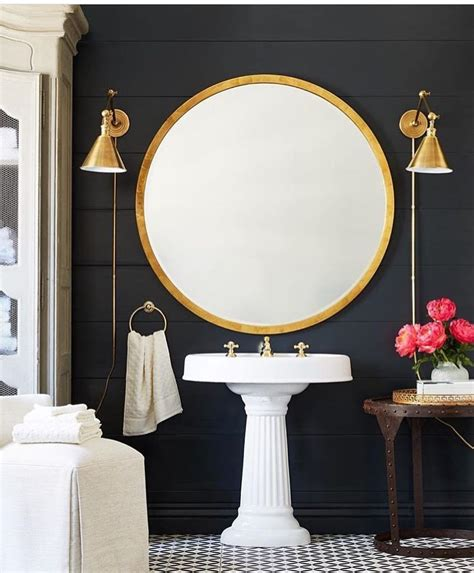 gold bathroom mirrors gorgeous gold round mirror and brass wall sconces in this