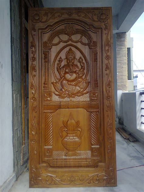 interior home designs wooden teak door  ganapathi papa