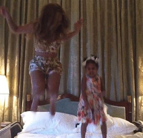 jay holiday bed video beyonce blue ivy jump on bed together family