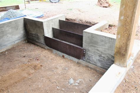 concrete retaining wall concrete retaining wall and corten steel risers stairs steps treads rails