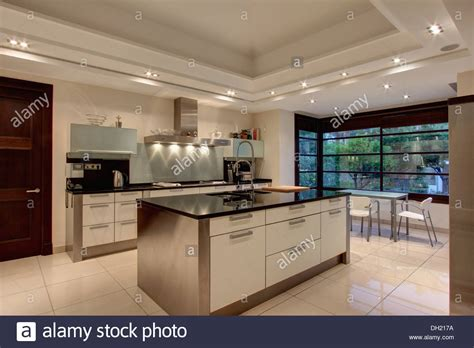 Kitchen Island Designs by Down Lighting On False Ceiling In Modern Spanish Kitchen