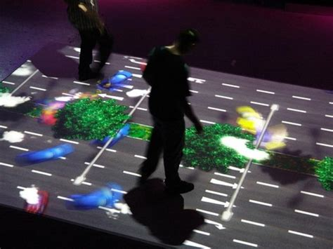 interactive floor arcstream living image interactive floor at the science museum slashgear