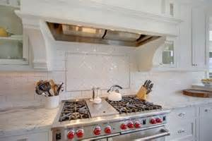 pillow tile backsplash herringbone tile stove top with pencil outline and