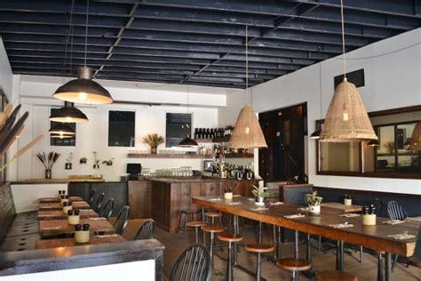 Barn Style Restaurants Barn Lights Factory Stools Add To Industrial Farmhouse