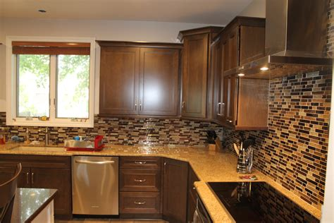Cabinets Light Granite by Medium Maple Cabinets With Light Granite Countertops And