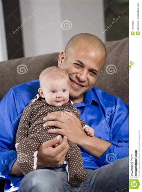 the babys lap book happy dad with baby sitting on lap stock image image 14428289