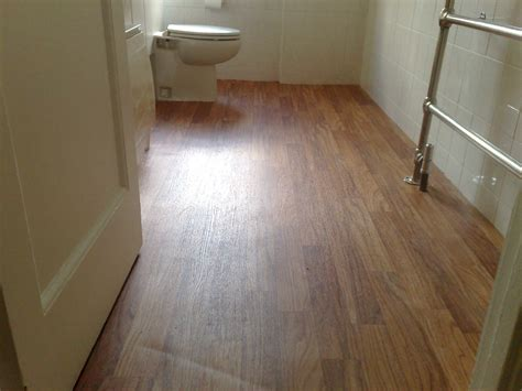 white laminate flooring for bathroom decoration is laminate flooring real wood in your