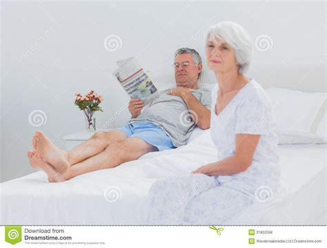 granny bed mature woman sitting on bed royalty free stock photos image 31802598