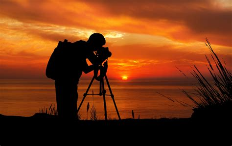 photography photos photographer at sunset silhouette free stock photo