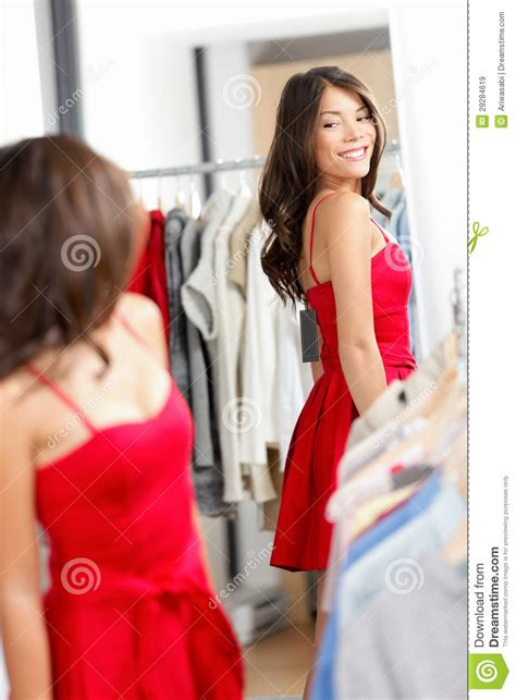 shopping looking in mirror trying clothes dress