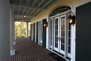 Chateau Bookcase Shutters For French Doors Exterior Traditional With Brick