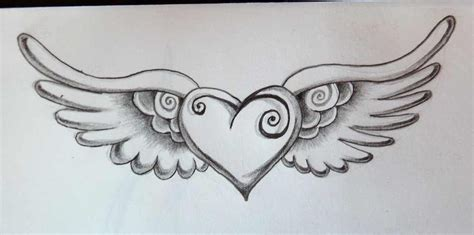 heart with wings tattoos with wings