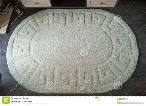 white oval rug a large white oval rug on a laminate stock photo image 58657625