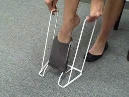 sock aid demonstration medi butler white metal sock compression aid kapiti wellington wheelchairs shower stools