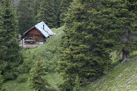 mountain side house tiny house in a landscape