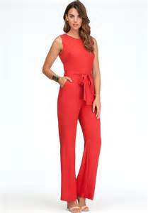 bebe back cutout jumpsuit in red lyst