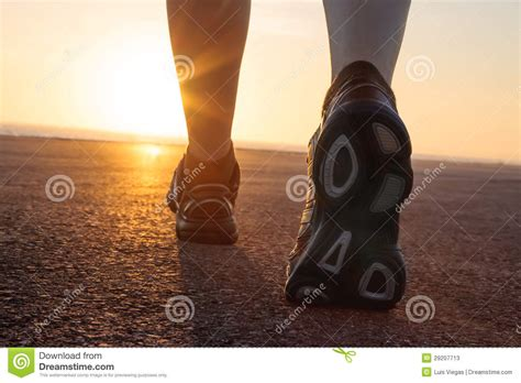 boots running time running shoes in tarmac with sunset stock photos image