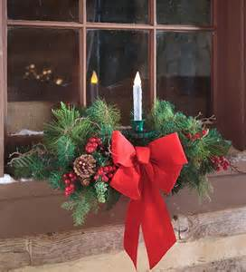 holiday window swag with candle outdoor holiday decorations