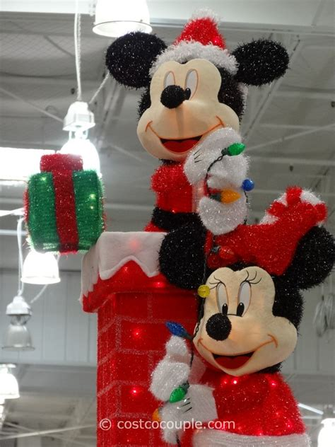 mickey and minnie decorating the chimney