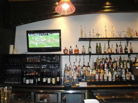 view of restaurant bar setup with flatscreen tv s sunday afternoon game of the washington redski