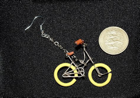 bike earrings made out of paper kuriositas