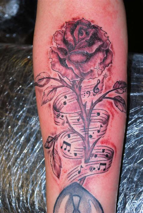 music notes with roses tattoo musical