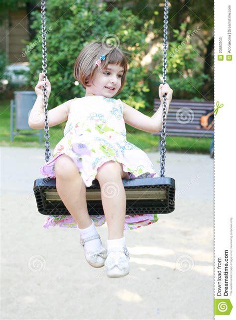 little girl on swing little girl on swing happy little girl smiling on swing