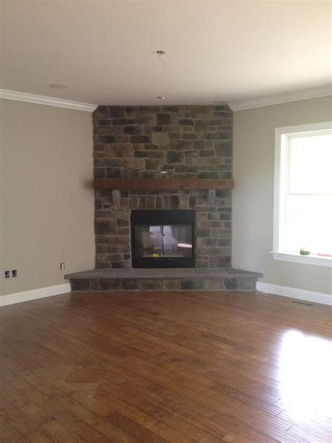 finished great room fireplace cobblestone barn beam