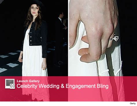 troian bellisario shows engagement ring for the
