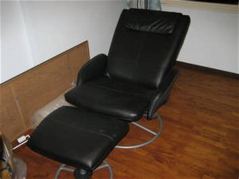malung leather swivel arm chair and matching