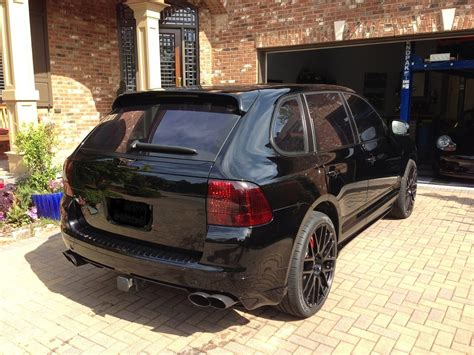 porsche cayenne blacked out want to swap my blacked out trim for your aluminum