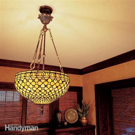 Hanging A Light Fixture From The Ceiling How To Hang A Ceiling Light Fixture The Family Handyman