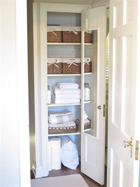 Bathroom Closet Organizer by Small Bathroom Closet Organizer With Wooden Shelving Unit