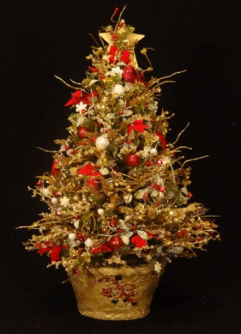 mini decorated lighted christmas tree in red green gold and