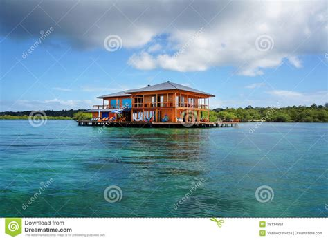 house over water house on stilts over water of the caribbean sea stock