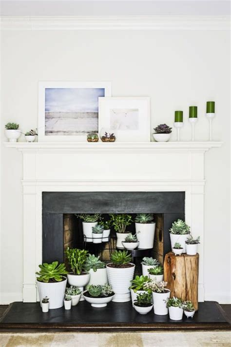 how to decorate empty space next to fireplace best 25 unused fireplace ideas on pinterest stacking