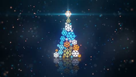 blue orange christmas tree shape of glowing snowflakes