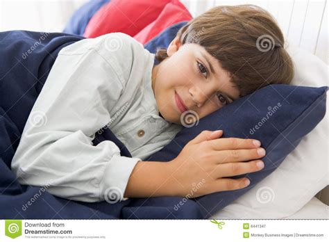 lying down in bed young boy lying down in his bed royalty free stock photography image 6441347