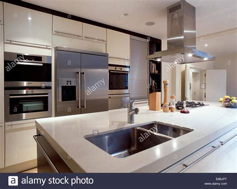 island extractor fans for kitchens steel extractor fan above island unit with underset steel stock photo royalty free image