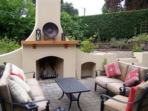 outdoor fireplace in stucco traditional patio