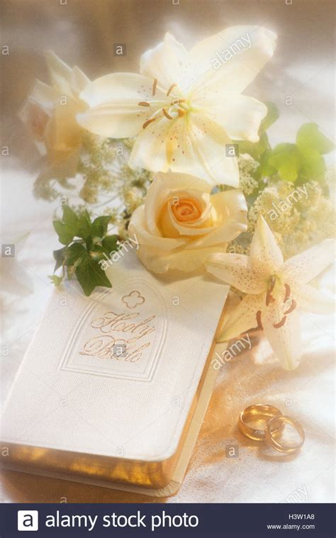 wedding bible pictures wedding still with bible rings flowers stock photo