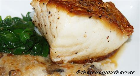 pan seared sea bass with mushroom grits the saucy southerner