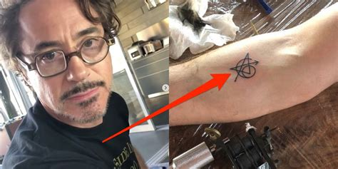 robert downey jr tattoo avengers robert downey jr got an avengers tattoo for movie s