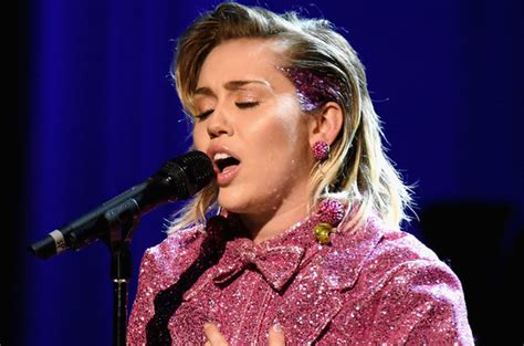 what kind of haircut does miley cyrus have miley cyrus throws support behind hilary clinton with new
