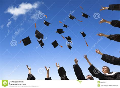 design is in the air students throwing graduation hats stock photo image
